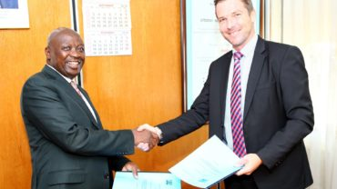 Eng. Joseph K. Njoroge MBS, Principal Secretary of the Ministry of Energy and Mark Lister, senior strategic advisor from UNEP DTU Partnership, with the new five-year agreement. Photo: Kenya Ministry of Energy